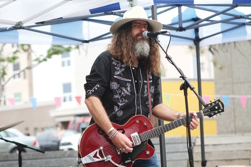 Ryan Chrys of the Ryan Chrys and the Rough Cuts band, performs at Belmar Plaza on Aug. 28.